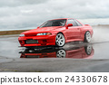 Nissan skyline R 32 red color on a wet road 24330678