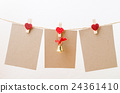 Blank paper and bell hanging on heart clothesline  24361410