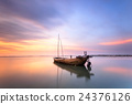 The remains of ancient ships in sunset 24376126