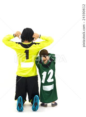 Woman goalkepper and her little fan in studio 24390612
