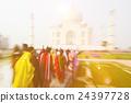 People walking through the Taj Mahal Concept 24397728