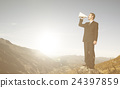 Businessman Shouting on the Top of the Mountain 24397859