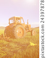 Mongolian Farmer Driving His Tractor On The Field Concept 24397878