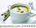 Bowl of asparagus soup with fresh cream and dill 24440400