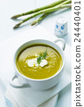 Bowl of asparagus soup with fresh cream and dill 24440401