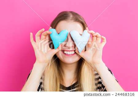 A woman with a small heart cushion 24468316