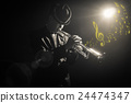 Musician playing the Trumpet with spot light and len flare with music notes on the stage 24474347