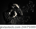 Songer hand holding the microphone and singing with music notes or melody on black background, musical concept 24475089