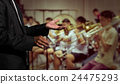 Orchestra conductor hands leading over the Abstract blurred photo of classic music band when rehearsal, musical concept 24475293
