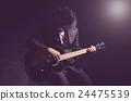 Musician playing the guitar on black background,music concept 24475539