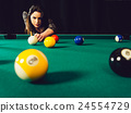 Beautiful woman playing pool 24554729
