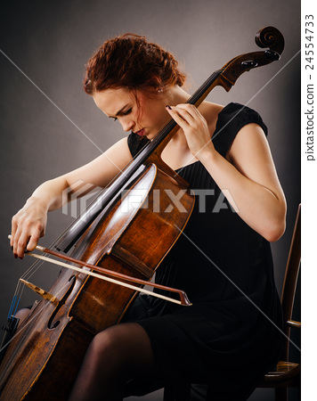 Cello player concentrating on her playing 24554733