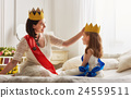 queen and princess in gold crowns 24559511