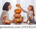 family preparing for Halloween. 24559520