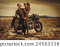 Stylish cafe racer couple on the vintage custom 24563338