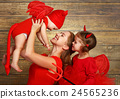 happy family with costumes devil prepares for Halloween 24565236
