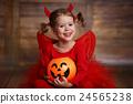 funny child girl in devil halloween costume on  dark wooden back 24565238