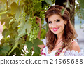 Beautiful young woman in traditional bavarian 24565688