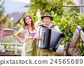 Couple in traditional bavarian clothes with 24565689