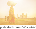 Indian Woman Carrying on Head and Goats near the Taj Mahal 24575447