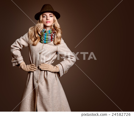 Stock Photo: Fall Fashion. Woman in Autumn Outfit. Stylish Coat
