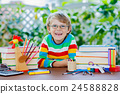 Happy school kid boy with glasses and student 24588828