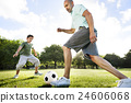 Dad Son Playing Football Together Concept 24606068