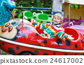 Little kid boy on carousel in amusement park 24617002