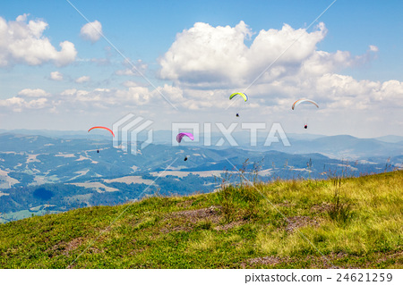 Skydiving  extreme over the mountains 24621259