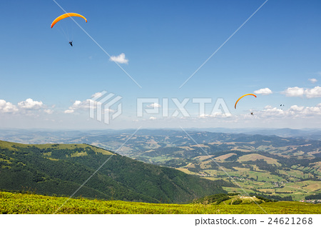 Skydiving  extreme over the mountains 24621268