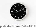 Black clock hanging at the wall 24624810