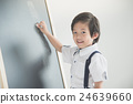 child writing on the chalkboard 24639660