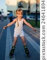 Little pretty girl on roller skates at a park 24641894