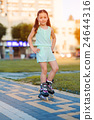 Little girl on roller skates in helmet at a park 24644316