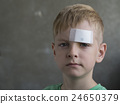 boy with a plaster 24650379
