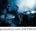 Silhouette of the drummer on stage. 24670829