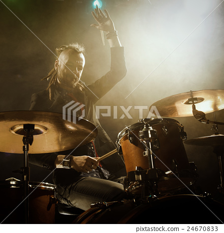 Silhouette of the drummer on stage. 24670833