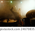 Silhouette of the drummer on stage. 24670835
