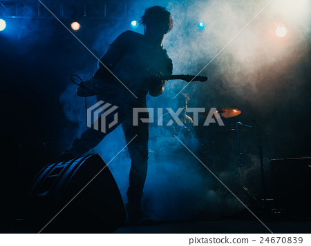 Silhouette of https://s3-apguitar player on stage. 24670839