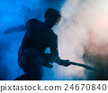 Silhouette of guitar player on stage. 24670840