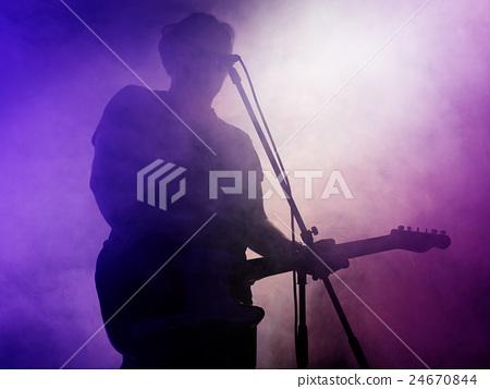 Silhouette of guitar player on stage. 24670844