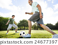 Dad Son Playing Football Together Concept 24677397