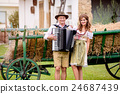 Couple in traditional bavarian clothes with 24687439