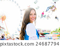 woman standing in front of ferris wheel 24687794