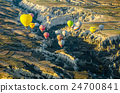 Hot air balloon over volcanic rock landscape 24700841