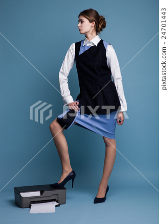 Businesswoman in working suit standing on printer 24701443