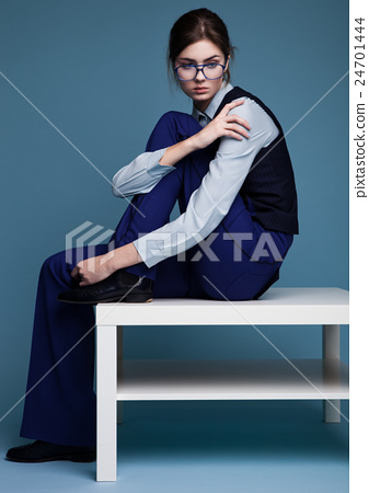 Businesswoman portrait with glasses and blue suit with hand on her shoulder 24701444