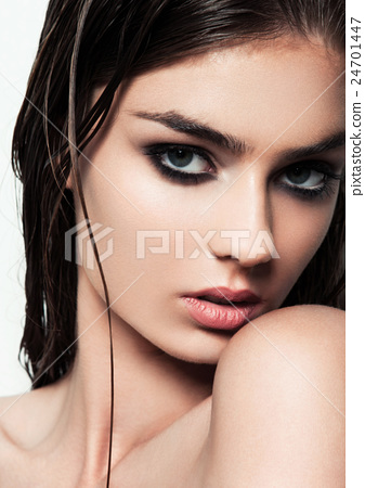 Beautiful woman with make up and wet hair on white background 24701447