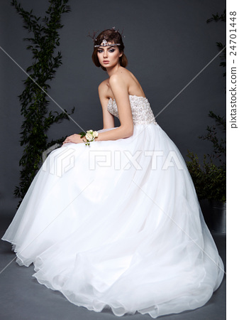 Young bride woman in wedding dress on grey background - Stock Photo ...