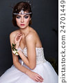 Young bride woman in wedding dress on grey background 24701449